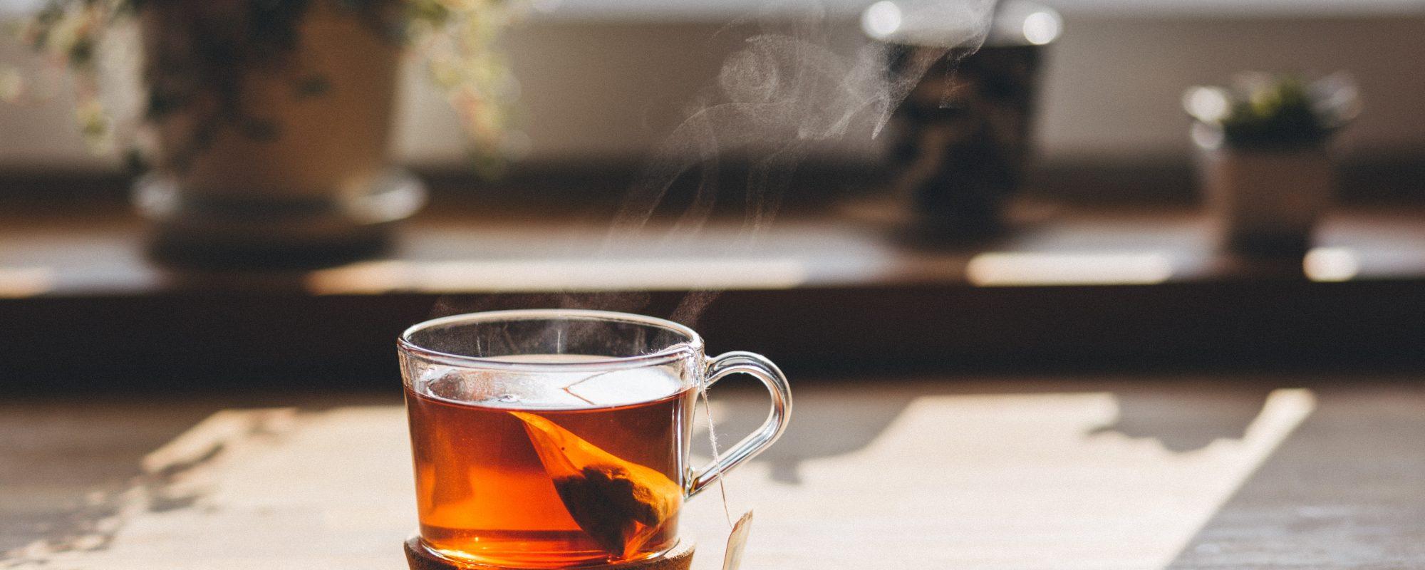 negative-space-cup-hot-tead-wood-table-joanna-malinowska